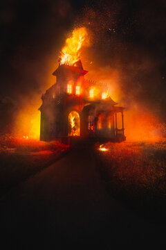 3D Rendering, illustration of a burning victorian style house at night. high contrast image
