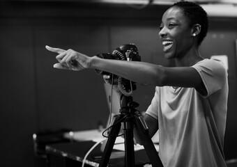 Fototapeta Cheerful photographer giving instructions in the studio obraz