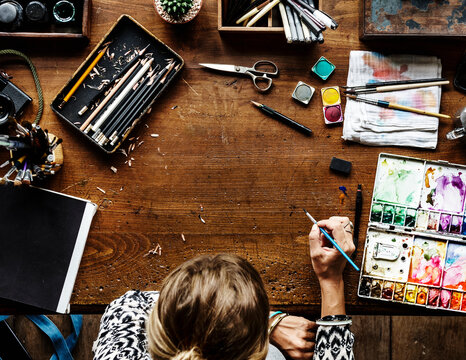 Artist drawing with watercolors