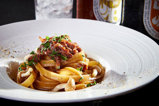 luxury fine dining western cuisine main course menu fried pasta noodle with chef bolognese sauce