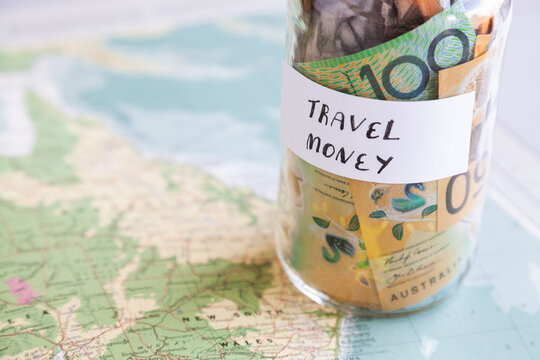 Travel in Australia concept with money and map