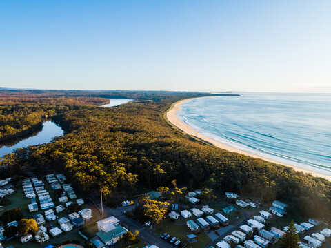 coastal caravan park full of cabins to book a holiday in in NSW