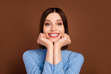 Photo of nice short hairdo millennial lady hands face wear blue blouse isolated on brown color background Wall mural