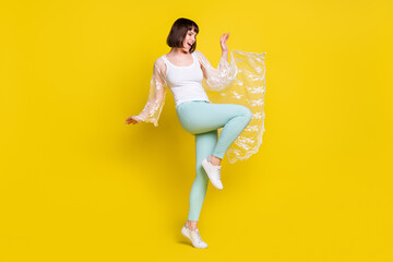 Full size photo of cheerful nice young charming woman funky funny summer isolated on yellow color background Wall mural