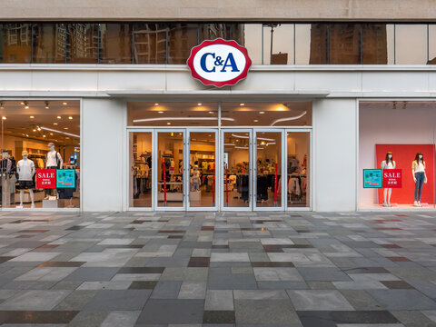 ZHENGZHOU, CHINA - Jul 06, 2021: Front of a retail shop of the international brand C&A on a Chinese street
