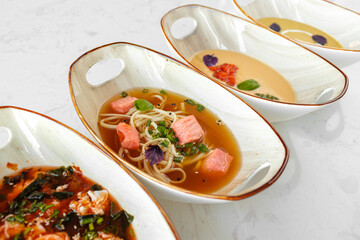 Tom Yam, Miso soup and cream soups on gray table