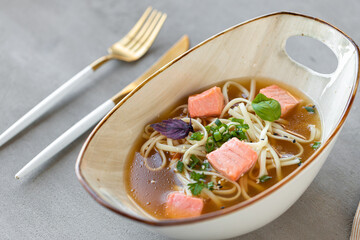 Japanese miso soup with salmon and tofu cheese