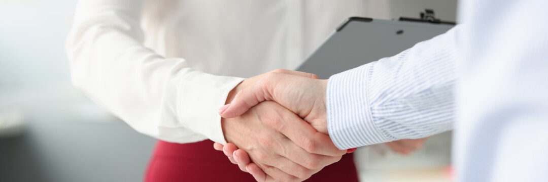 Business people shake hands in handshake closeup