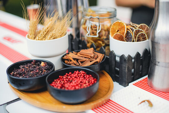 Shallow depth of field (selective focus) image with spices on the counter of a bar during a garden party.