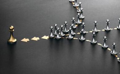 Obraz Leader and followers over black background. Good leadership concept. - fototapety do salonu