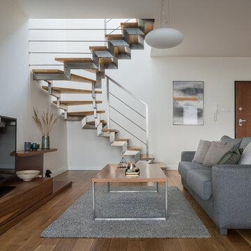 Modern stairs in simple living room