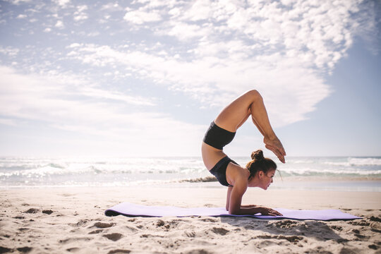 Pincha Mayurasana Scorpion yoga pose