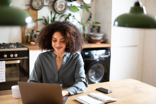 African American businesswoman working from home on a video call