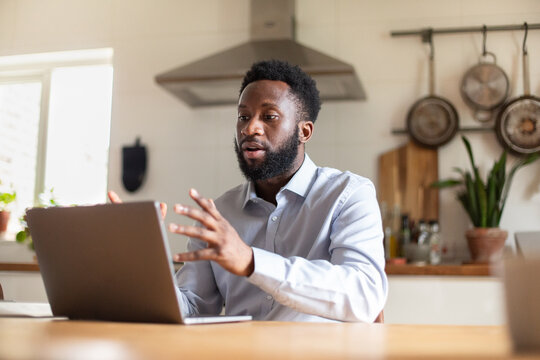African American businessman working from home on a video call