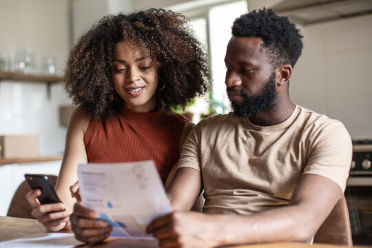 African american couple paying bills together