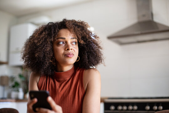 African American young adult female using smartphone