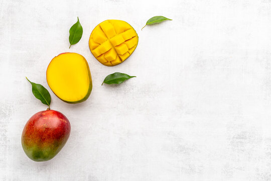 Layout of mango and leaves. Tropical fruits background