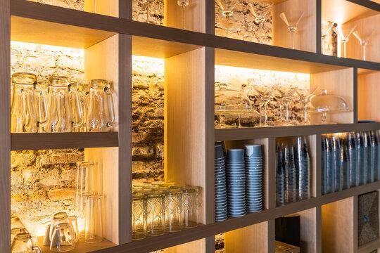 Glasses arranged on shelf in bar