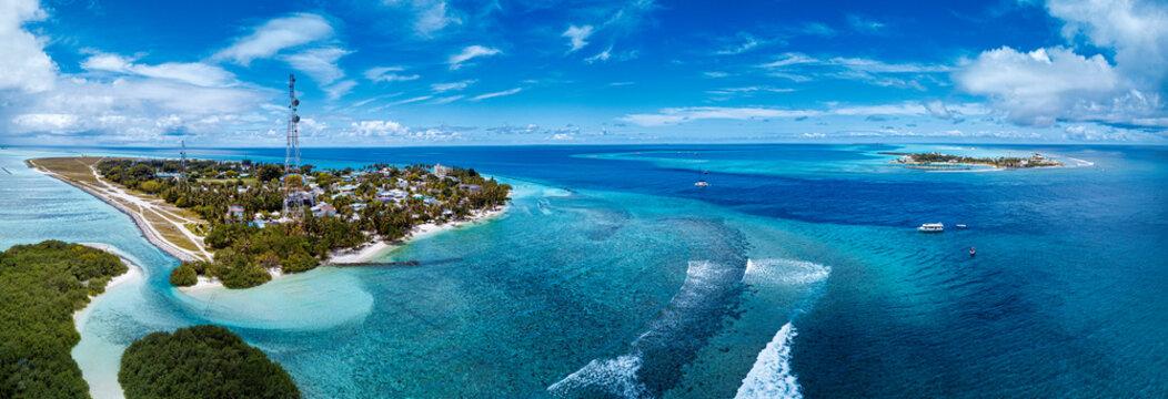 Thulusdhoo Island amidst blue sea at Kaafu atoll, Maldives