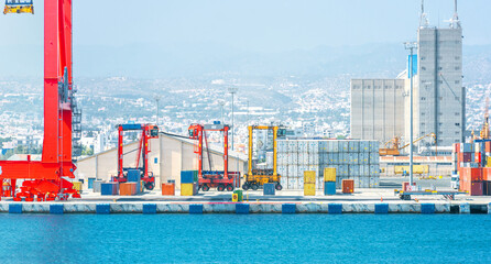 Obraz Shipping container carriers in cargo terminal of Limassol port (Cyprus) - fototapety do salonu