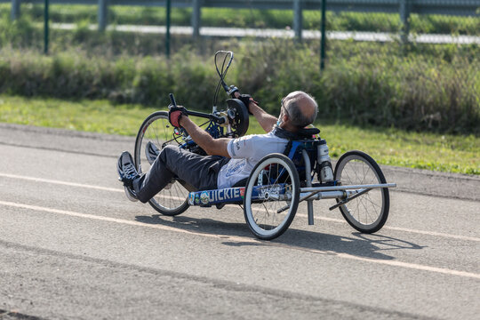 Parma, Italy - October 2020: Senior Athlete training with His Hand Bike on a Track