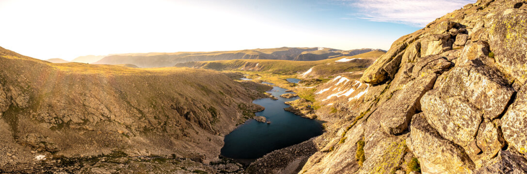 Sunrise over alpine lakes in the mountains panorama