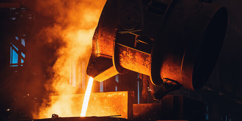 Fototapeta Molten metal pouring from big ladle. Iron cast process.Metallurgical plant. Steel mill factory. obraz