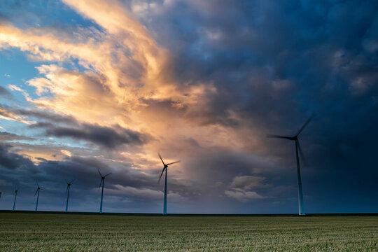 dramatic stormy sunset on Dutch farmalnd