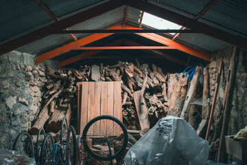Obraz Old wooden shed with equipment and bikes - fototapety do salonu