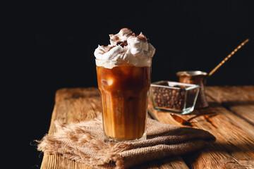 Fototapeta Glass of iced coffee on wooden table obraz