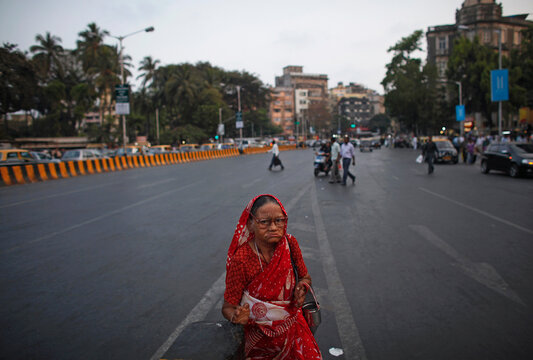A woman affected by leprosy begs for alms at a traffic junction in Mumbai