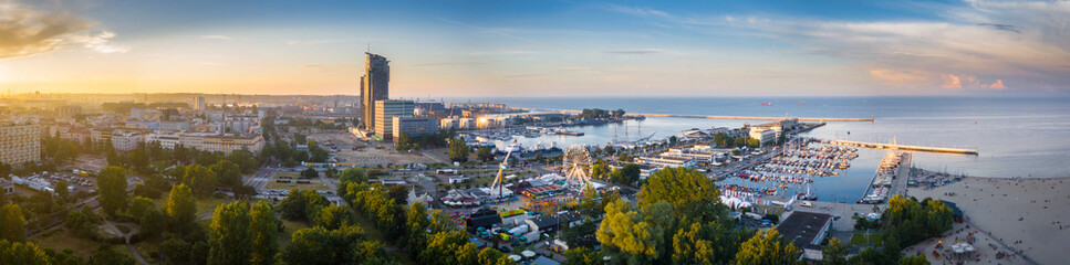 Obraz Aerial panorama of the harbor in Gdynia with modern architecture at sunset. Poland - fototapety do salonu