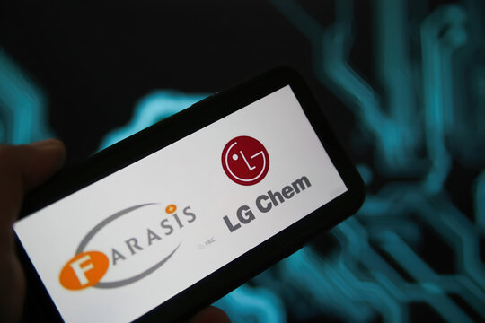 Viersen, Germany - May 9. 2021: Closeup of phone screen with logo lettering of battery manufacturer farasis energy and lg chem, blurred power circuit background