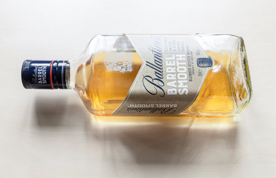 MOSCOW, RUSSIA - JUNE 10, 2021: open bottle of Ballantine's Barrel Smooth whisky. Ballantine's Scotch whisky was introduced 1827, today this brand belong to Pernod Ricard