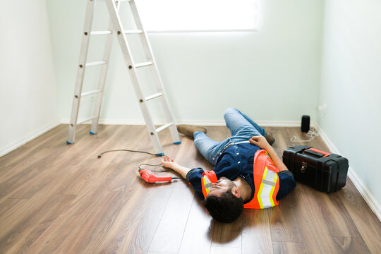 Hispanic electrician having a work accident