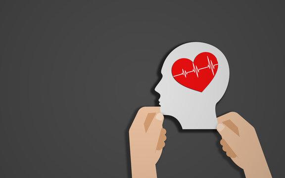 Hand Holding Human Head Shape and heart Shape Braun. World mental heath day, world health day and wellness concept. Black Background