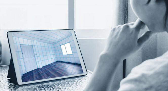 Interior room design and renovation on digital tablet