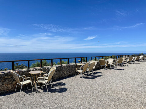 Empty chairs with sea view and blue sky