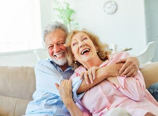 Fototapeta senior portrait woman man couple happy  retirement smiling love elderly lifestyle old together active healthy vitality hugging bonding romance having fun obraz