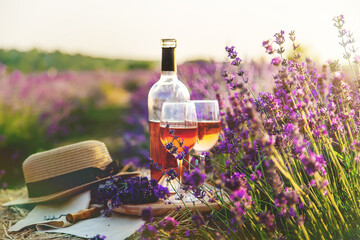 Wine in glasses. Picnic in the lavender field. Selective focus.