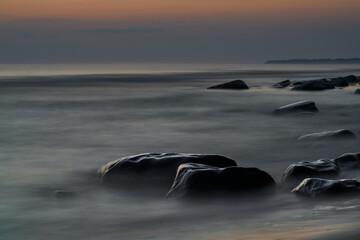 Obraz seascape of rock light sunset, Long exposure - fototapety do salonu