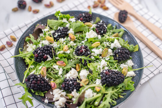 healthy summer salad with berries and feta cheese