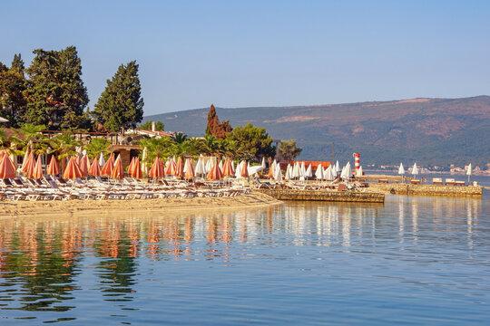 Summer beach vacation. Beautiful Mediterranean landscape on sunny summer morning. Montenegro,  Adriatic Sea, Bay of Kotor, Tivat city