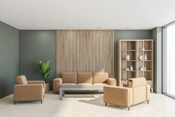 Fototapeta Cupboard and beige furnishings in the green living room space obraz