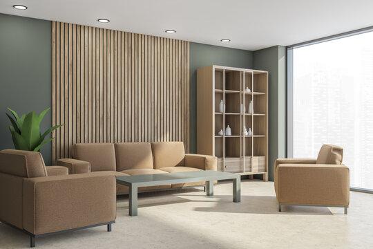 Beige furnishings of the living room corner in mild shade of green