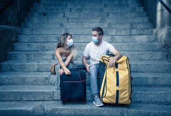 Fototapeta Sad and frustrated tourist couple not able to travel abroad due to post covid travel restrictions obraz