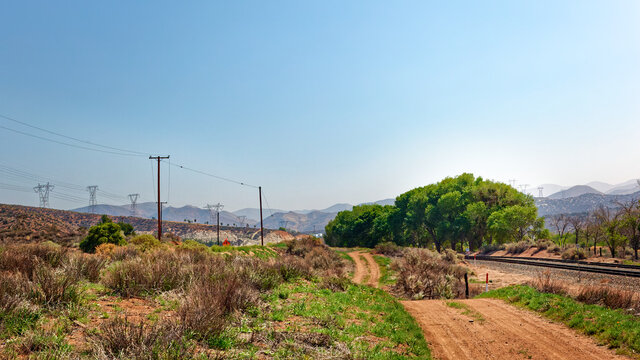 Sandy dirt road beside rail line in northern L.A. country.