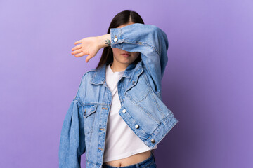 Obraz Young Chinese girl over isolated purple background covering eyes by hands - fototapety do salonu