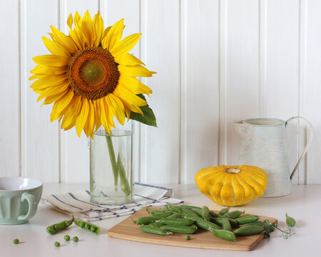 light still life with sunflower and vegetables.