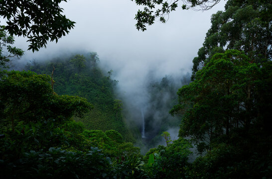 Costa Rica San Fernando Waterfall in the cloud forest, green jungle, view from the air and from the hill. Cinchona restaurant mountain landscape view, fog and clouds above the waterfall in the jungle